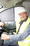 Driver man driving van truck over building construction. Site Stock Photo