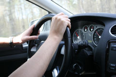 Driver man holds a steering wheel Royalty Free Stock Photos
