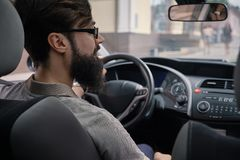 Driver man paying attention to road Stock Image