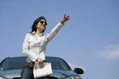 Driver with a map. Woman with map looking on the road Royalty Free Stock Images