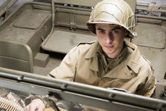 Driver of a military vehicle of World War II. With green helmet royalty free stock image