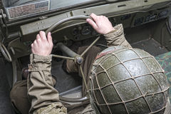 Driver of a military vehicle of World War II. With green helmet Stock Photography