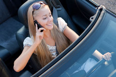 Driver with mobile. Girl driver with mobile phone, in the car Stock Photos