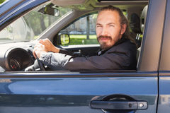 Driver of modern suv, portrait in open car window Royalty Free Stock Photography