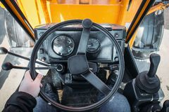 Driver in modern tractor or excavator cabin, view from driver eye position. Driver in modern combine or tractor or excavator cabin, view from driver eye position Stock Photo