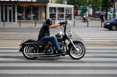 The driver of the motorcycle. Driving fast, fast motorcycle, riding down the street royalty free stock photography