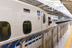 Driver in N700 Series Shinkansen in Osaka train station Royalty Free Stock Photography