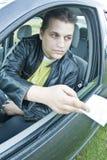 Driver offering envelope Stock Images