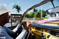 Driver of Old car in Havana, Cuba royalty free stock image