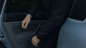 Driver opening car door to young respectable oligarch, professional chauffeur. Stock footage stock footage