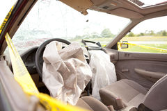 Driver and Passenger Airbags Deployed. Inside Automobile After Wreck.  Driver and Passenger Air Bags Deployed.  Windshield Shattered with yellow police tape Royalty Free Stock Image