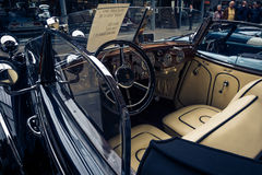 The driver and passenger of the vintage car Horch 853A Sport Cabriolet. BERLIN - MAY 10, 2015: The driver and passenger of the vintage car Horch 853A Sport Royalty Free Stock Photography