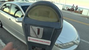 The driver pays for parking. The driver pays for the parking of the car, throws coins into the parking meter stock video