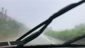 Driver Perspective in Poor Rainy Conditions. A driver's perspective driving in poor rainy conditions during a torrential downpour stock footage