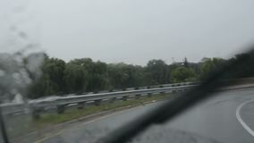 Driver point of view on rainy onramp to 401 expressway in Toronto stock footage