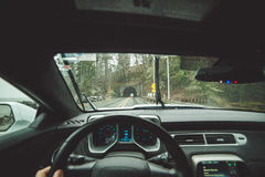 Driver POV inside car heading towards tunnel Royalty Free Stock Images