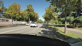 Driver POV personal perspective commuting in France. Strasbourg Hoenheim, France - Circa 2018: Driver POV at French road driving on Avenue Herrenschmidt with stock video