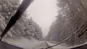 Driver POV view of winter snow drive stock video footage