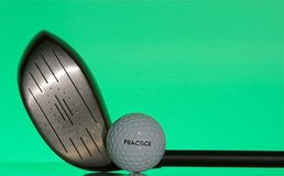 Driver and practice ball. Driver and ball labeled practice Stock Image