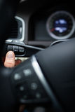 Driver pressing a button, using the car co Stock Photography