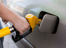 Driver pumping gasoline at the gas station Stock Image