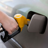 Driver pumping gasoline at the gas station Stock Photography