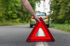Driver putting out a traffic warning sign Stock Images