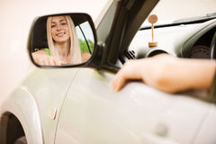 Driver is reflected in mirror Royalty Free Stock Photo