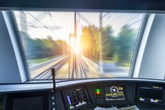 Free Driver`s Cab Of Speed Passenger Train, View Of The Railway Bridge With The Effect Of Speed Motion Blur. Royalty Free Stock Image - 127038136