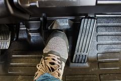 The driver`s foot To step on the brake pedal. The driver`s foot To step on the brake pedal Stock Image