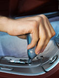 Driver's hand changing speed Royalty Free Stock Images