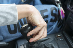 driver`s hand lies on the shift knob, Royalty Free Stock Photos