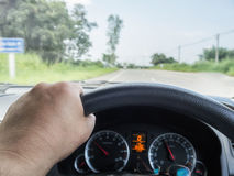 Driver's hand on the steering wheel. While driving car Royalty Free Stock Photo