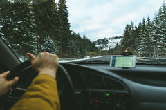 Driver`s hands on a steering wheel and blurred road Royalty Free Stock Photos
