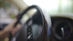 Driver's hands turning steering wheel of expensive vehicle, business leader. Stock footage stock footage