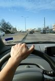 Driver's Perspective. A person drives down the road with a view out the front window Stock Image