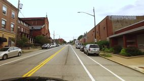 Driver`s perspective on street in Lawrenceville Area of Pittsburgh. Pittsburgh - circa September, 2016 - a driver`s POV riding on a road in the Lawrenceville stock video