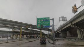 Driving Under I-279 Road Sign in Pittsburgh. A driver's perspective under an Interstate 279 directional road sign in downtown Pittsburgh, PA on a rainy winter's stock footage