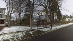 Driver's Perspective on Wintry Streets in Upscale Neighborhood. 10126 A driver's side perspective on the streets of an upscale residential neighborhood on a late stock video