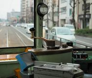 Driver`s seat in old tram in Japan stock photography