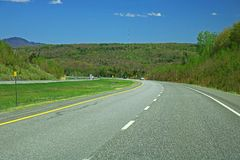 Driver`s View Of Quebec Highway 10. Traveling east on highway 10 going toward Sherbrooke, Quebec from Montreal and Granby. The mountains of the Eastern Townships royalty free stock images