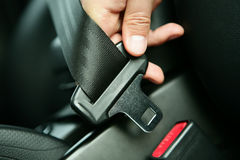 Driver seat belt. Fastening the seatbelt in the car Stock Photography