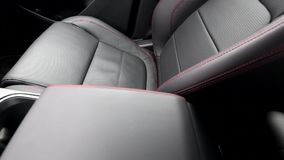 Red thread stitching of leather seat inside the car interior. Rail video footage. Driver seat with red thread stitching moving in leather car interior stock video