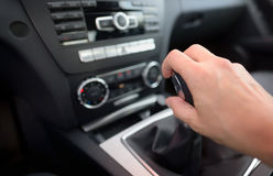 Driver shifting the gear stick. Inside of car Stock Image