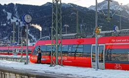 Driver of a shiny red train awaiting departure Royalty Free Stock Photography