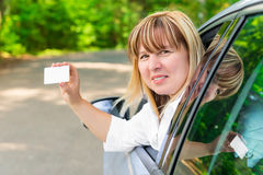 Driver showing a blank card Royalty Free Stock Images