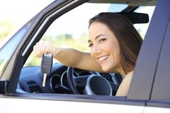 Driver showing the car keys to camera stock photography