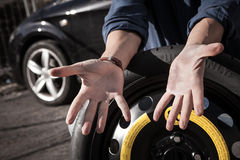 Driver showing his dirty hands Royalty Free Stock Images