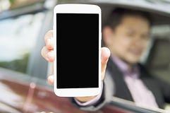 Driver is showing mobile phone Stock Photos