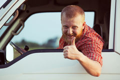 Driver shows that all is well. Bearded driver shows that all is well Stock Images